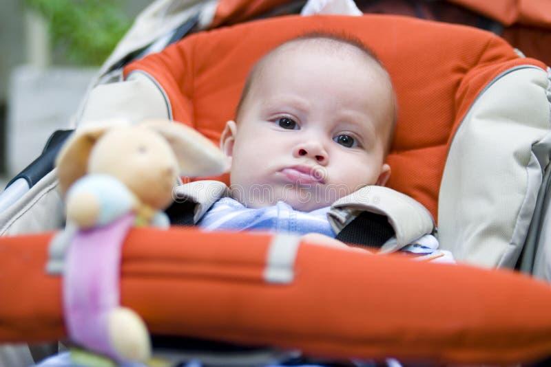 De Jongen van de baby in Wandelwagen stock afbeelding