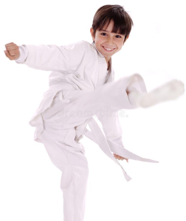 De jongen van de karate het excercising royalty-vrije stock fotografie