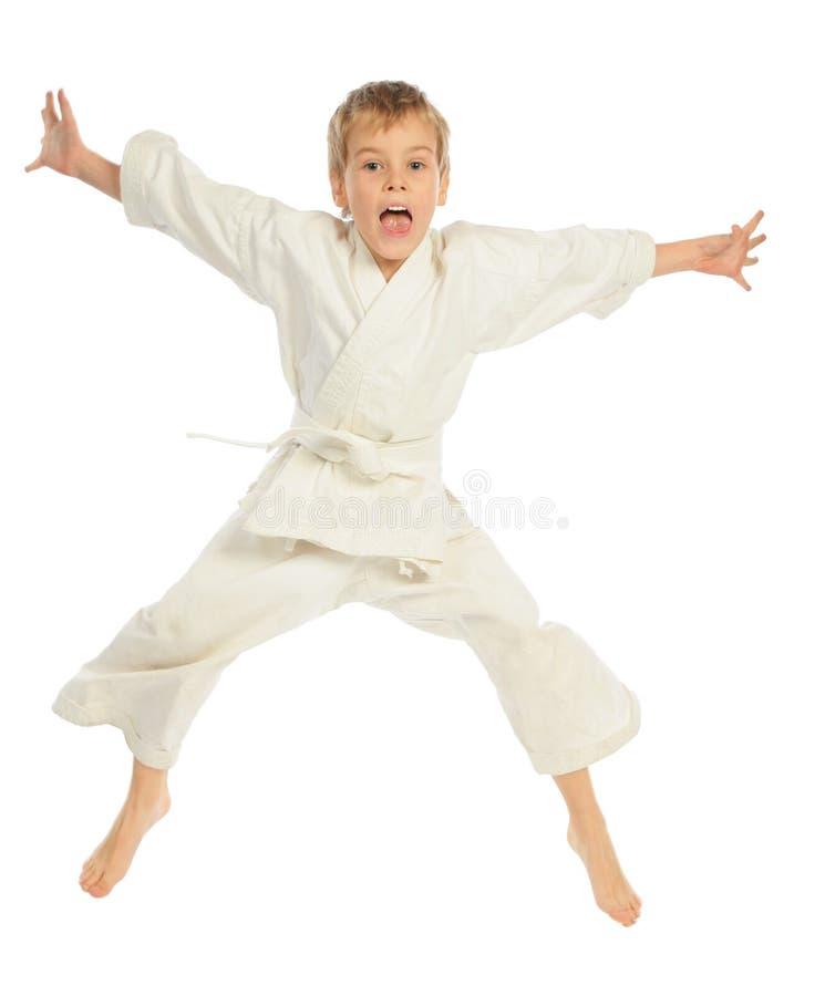 De jongen van de karate het springen stock fotografie