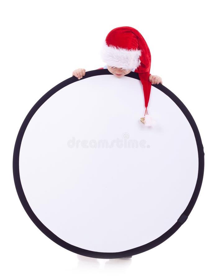 De jongen van de kerstman met groot teken stock foto's