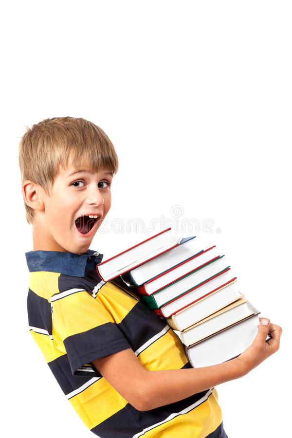 De jongen van de school houdt boeken royalty-vrije stock afbeeldingen