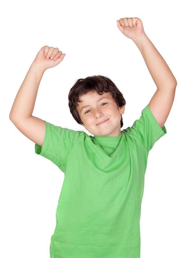 De jongen van de winnaar met groene t-shirt stock afbeelding