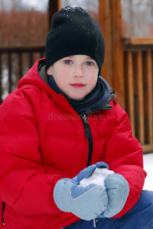 De jongen van de winter stock foto's