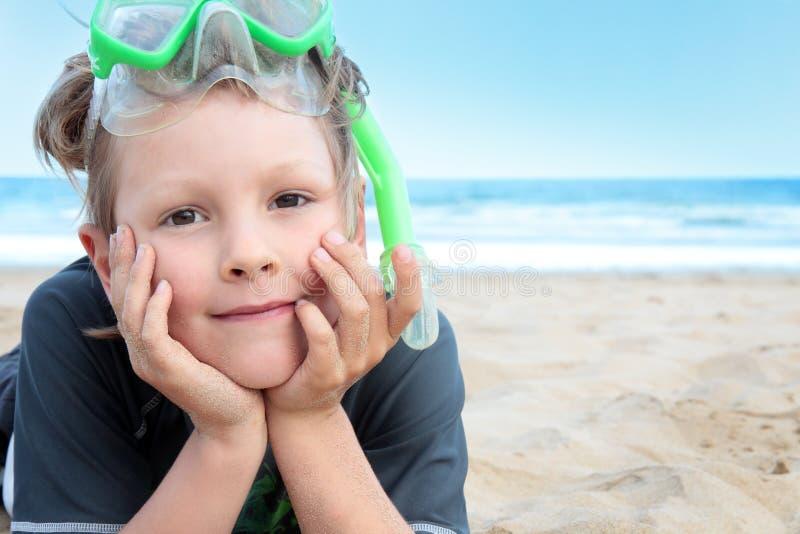 De jongen van het strand. stock fotografie