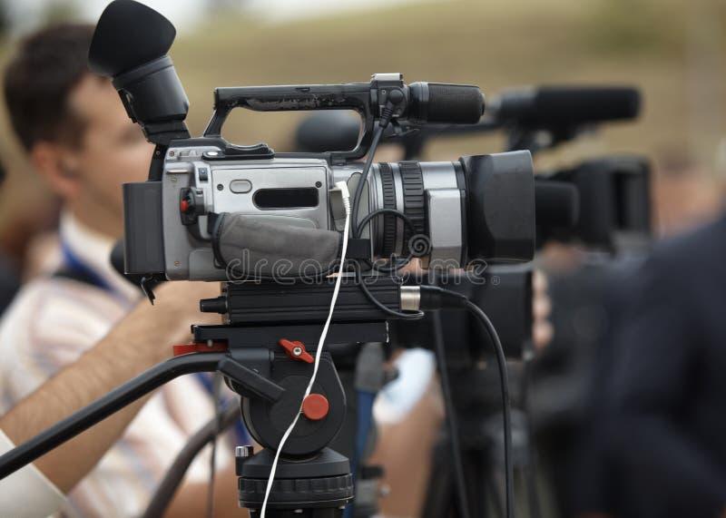 De journalistiek van de bedrijfsconferentiecamera stock afbeelding
