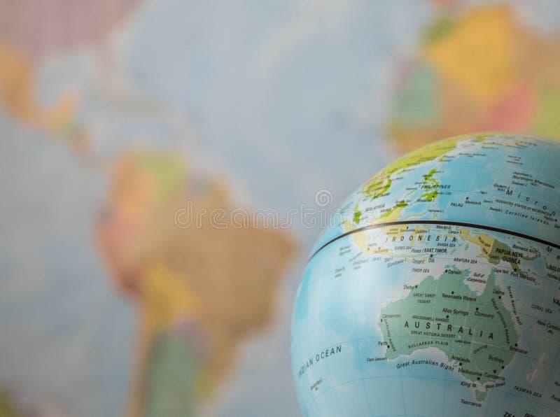 De kaart van Australië op een bol royalty-vrije stock afbeeldingen