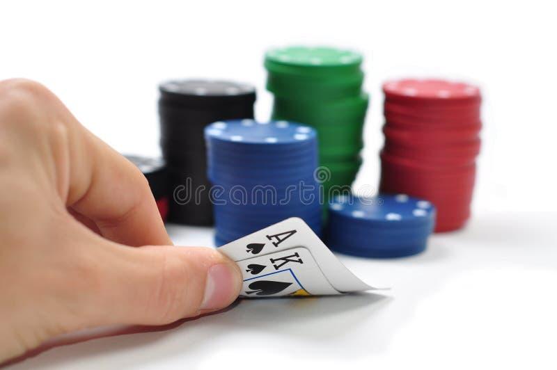 De kaarten en de spaanders van de pook stock foto's