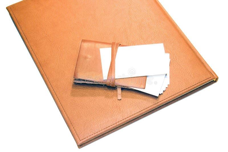 De kaartkaarthouder van Bisness op notitieboekje stock foto
