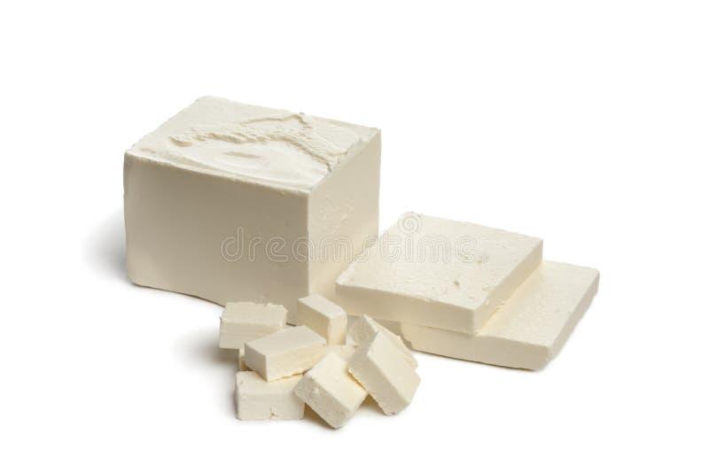 De kaas van feta met plakken en kubussen stock foto's