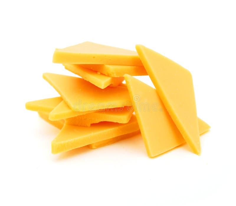 De kaasplakken van de cheddar stock foto's
