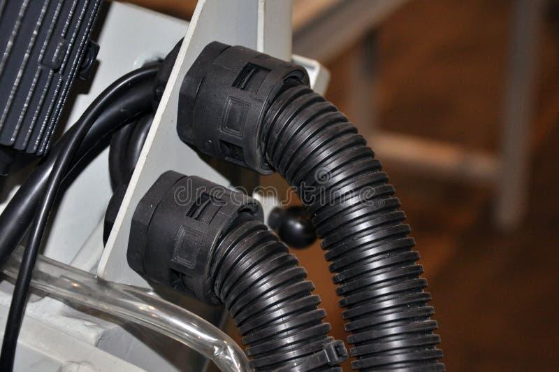 De kabel van de inputmacht aan de machine in een isolerende schede royalty-vrije stock foto's
