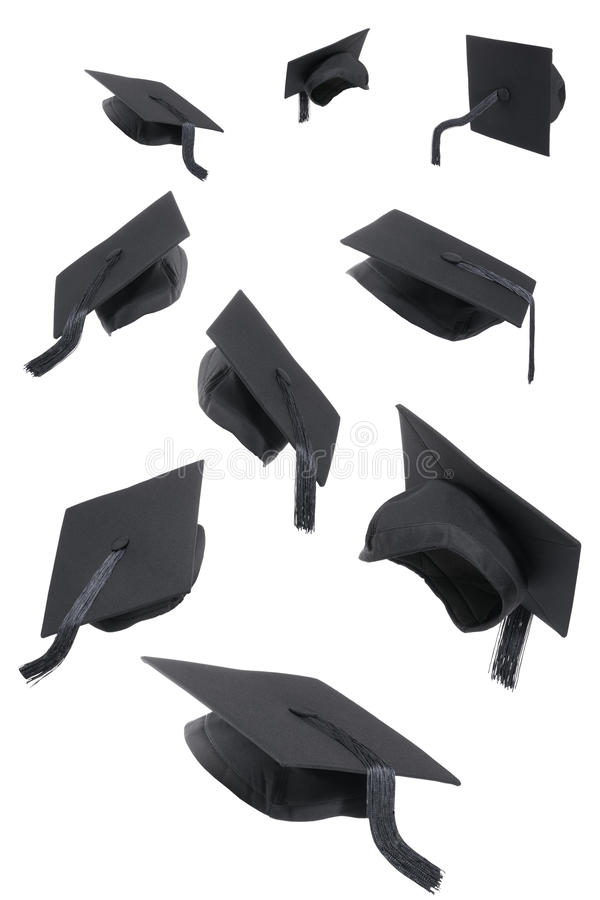 De Kappen van de graduatie op Wit stock afbeeldingen