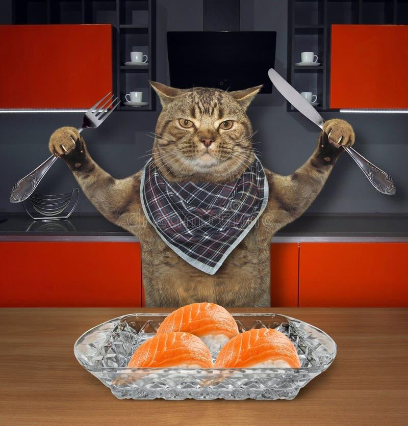 De kat eet sushi in keuken 2 royalty-vrije stock afbeelding