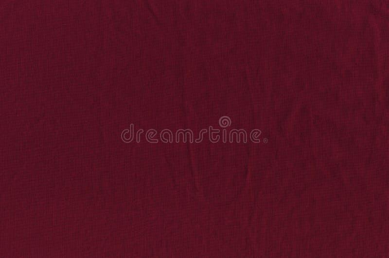 De katoenen stof van kleur is een getaande haven De achtergrond van Bourgondië stock afbeelding