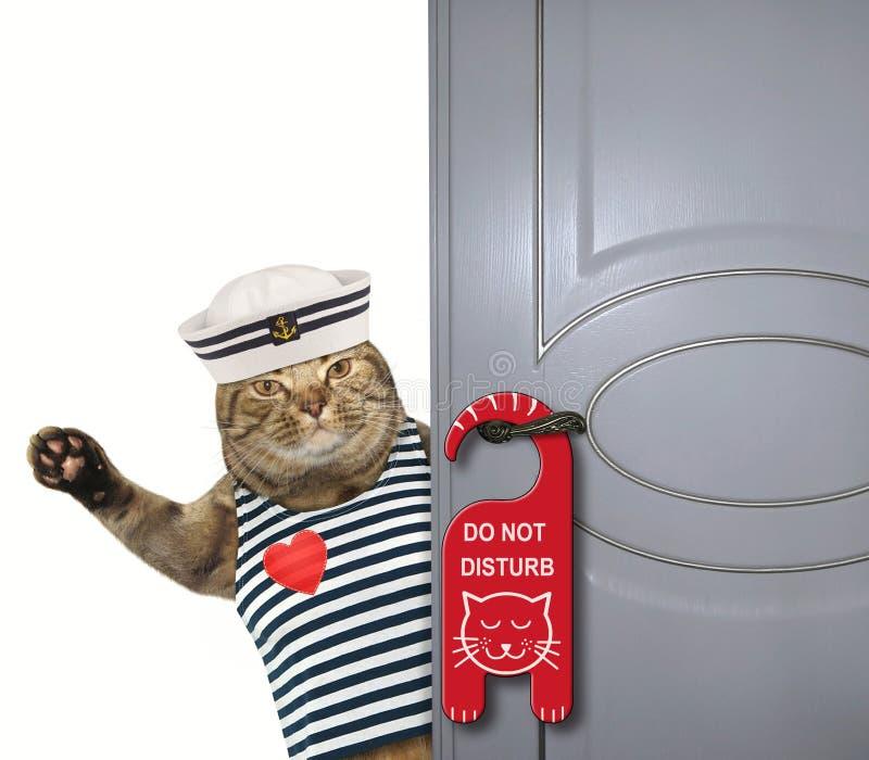 De kattenzeeman sluit de deur royalty-vrije stock foto