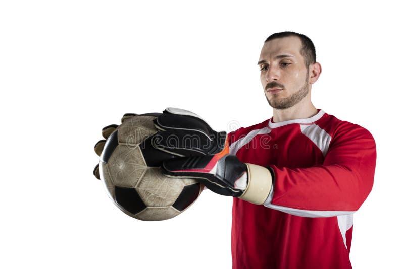 De keeper houdt de bal in het stadion tijdens een voetbalspel Ge?soleerdj op witte achtergrond royalty-vrije stock foto