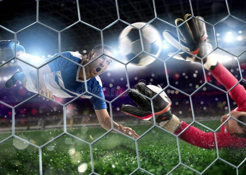 De keeper vangt de bal in het stadion tijdens een voetbalspel stock foto