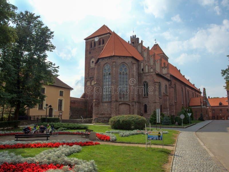 De Kerk van heilige George's, Basiliekminderjarige in Ketrzyn in Polen stock afbeelding