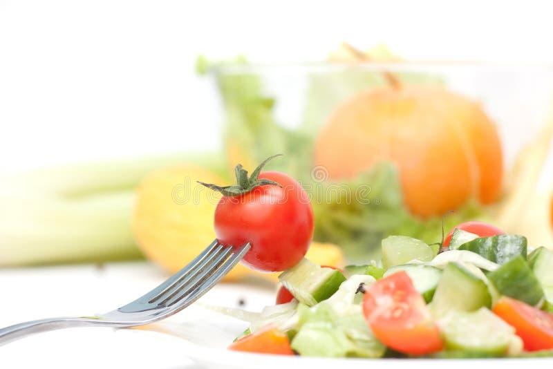 De kers van de tomaat op een vork. Dieet royalty-vrije stock foto's
