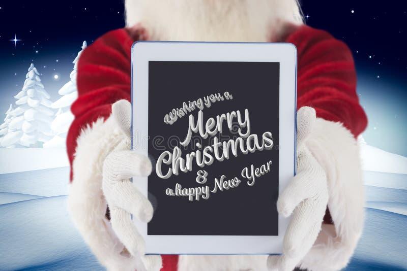 De Kerstman die digitale tablet met Kerstmisgroet tonen royalty-vrije stock afbeeldingen