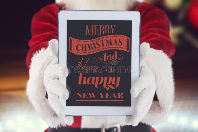 De Kerstman die digitale tablet met Kerstmisgroet tonen royalty-vrije stock foto