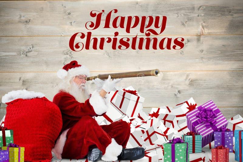 De Kerstman die door telescoop tegen digitaal geproduceerde achtergrond kijken stock afbeelding