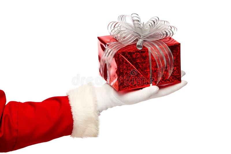 De Kerstman die Kerstmis huidige doos op a geven stock foto's