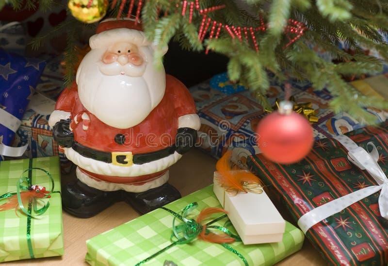 De kerstman en stelt voor stock fotografie
