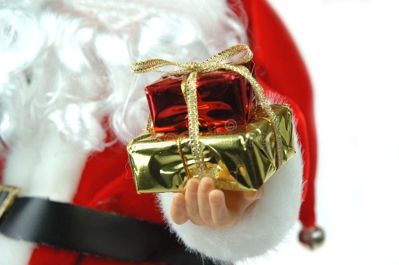 De kerstman en stelt voor royalty-vrije stock foto's