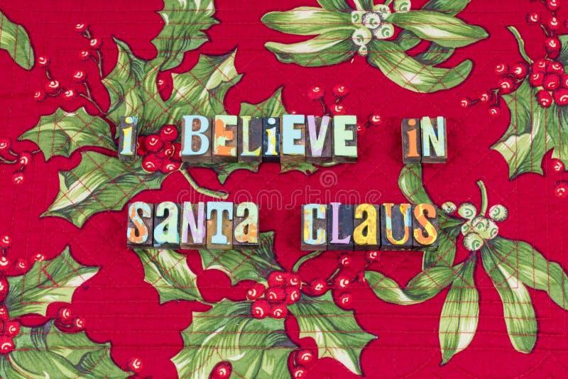 De Kerstman gelooft sprookjetypografie stock fotografie