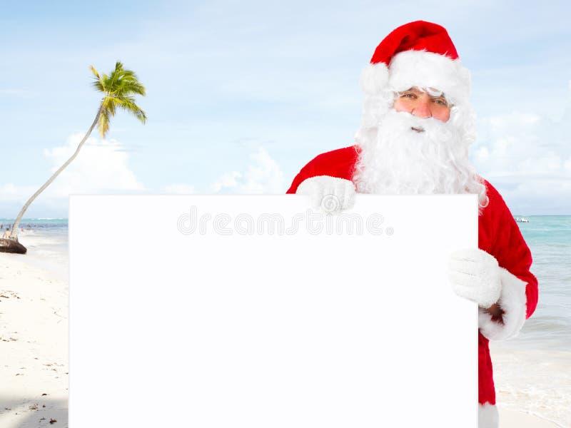 De Kerstman met banner stock afbeelding