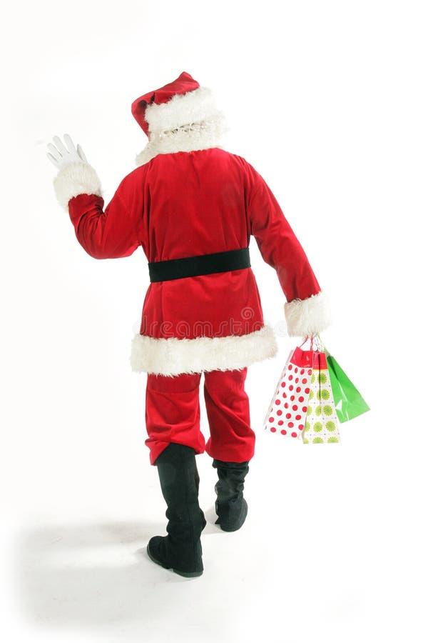 De Kerstman met het winkelen zak stock afbeelding