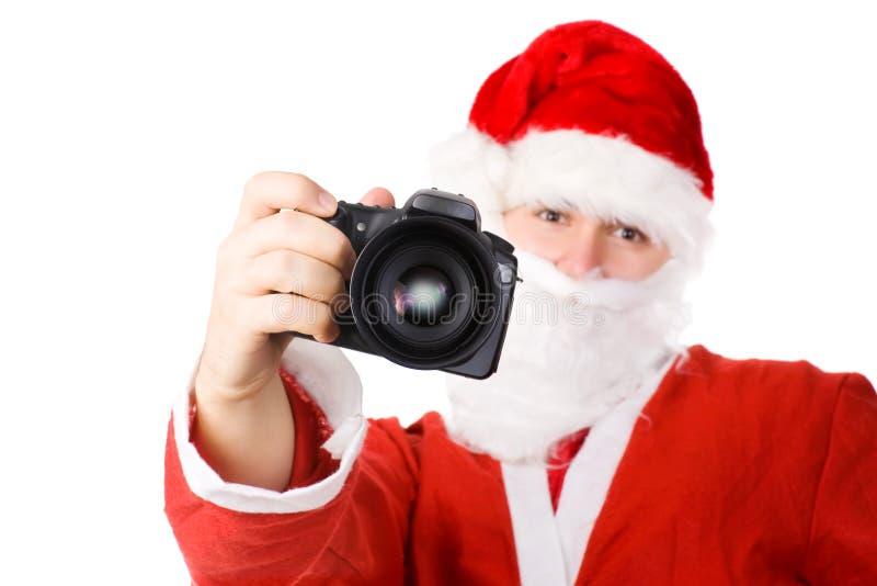 De Kerstman met moderne digitale camera royalty-vrije stock foto's