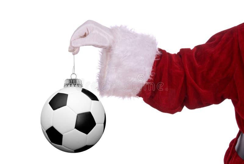 De Kerstman met voetbalornament stock fotografie