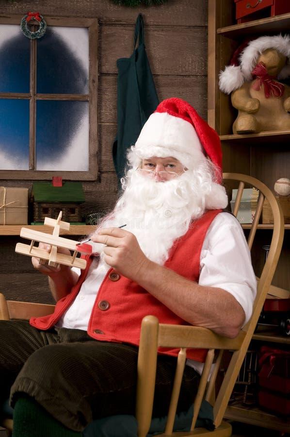 De Kerstman in Workshop royalty-vrije stock afbeelding