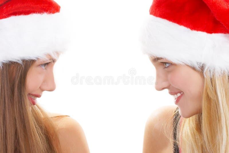 De Kerstmismeisjes stock foto's