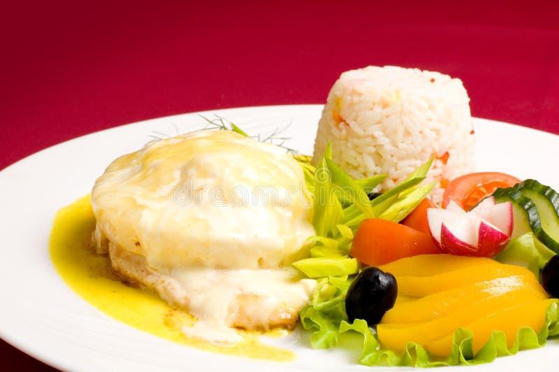 De kip van Gratinéed met risotto royalty-vrije stock foto