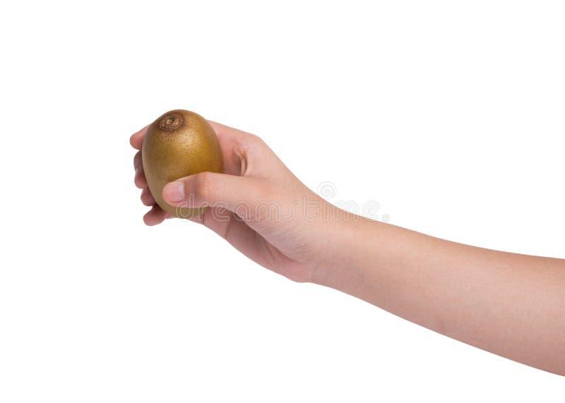 De kiwifruit van de handholding op witte achtergrond wordt geïsoleerd die royalty-vrije stock foto
