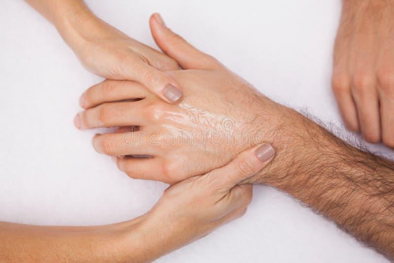 De klantenhand van de manicurewas royalty-vrije stock afbeelding