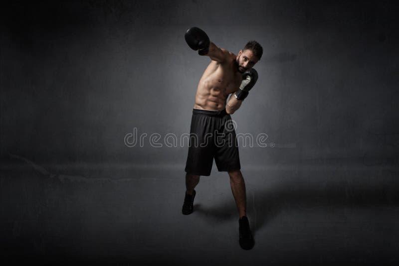De klap van de bokseraanval stock fotografie