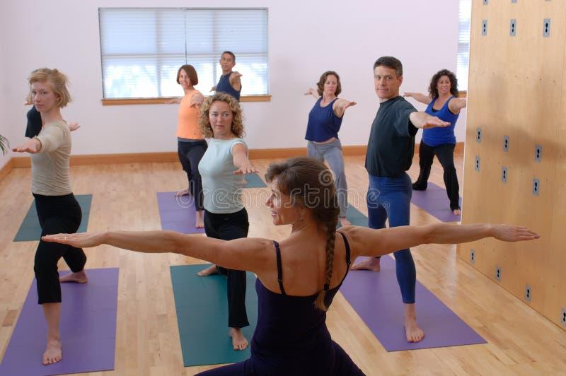 De Klasse van de yoga stock afbeeldingen