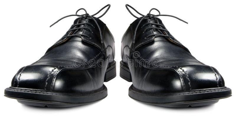 De klassieke geïsoleerdet close-up van de mensen zwarte club schoenen stock foto
