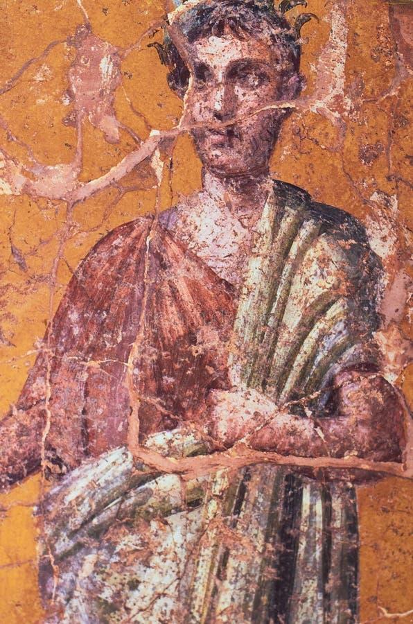 De kleding in oud Rome, Cijfer van een Roman mens schilderde in een Fresko in een Domus van Pompei royalty-vrije stock afbeelding