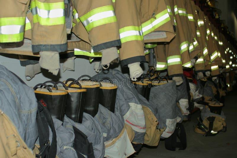 De kleding van de brandbestrijder stock foto's