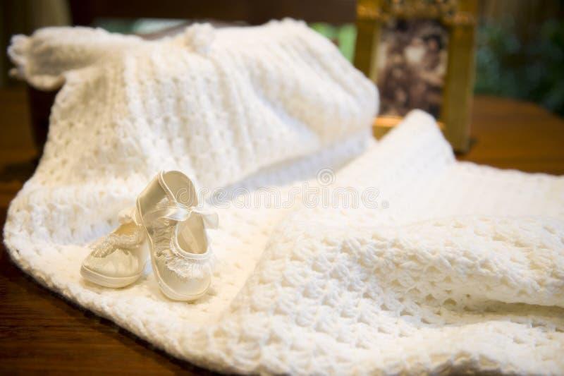 De kleding van het doopsel stock afbeelding