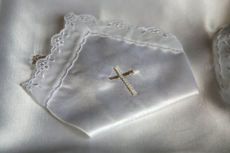 De kledingsdetail van het doopsel stock afbeelding