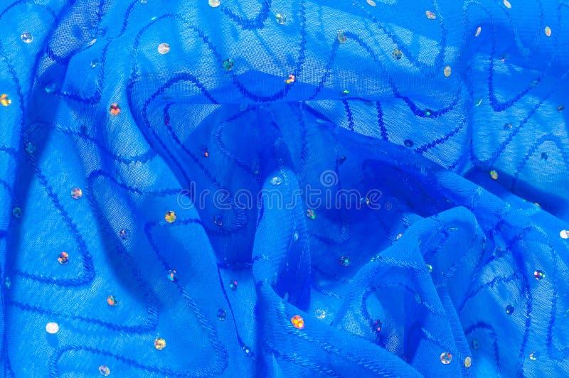 de kledingszijde van het meisje De polka is blauw De stof van het zijdekant met pipet royalty-vrije stock foto