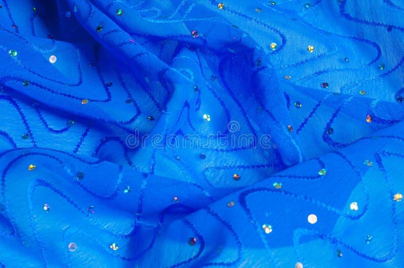 de kledingszijde van het meisje De polka is blauw De stof van het zijdekant met pipet royalty-vrije stock fotografie