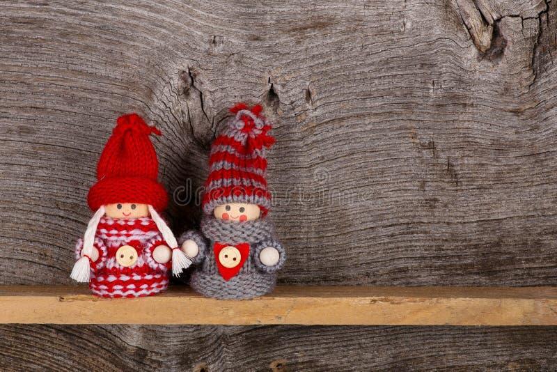 De kleine de Wintermarionet van Kinderenkerstmis stelt Rood Grey Nordic voor stock foto