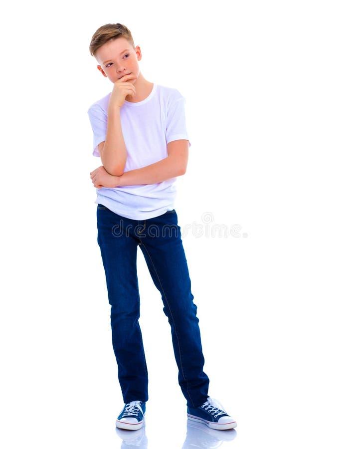 De kleine jongen denkt royalty-vrije stock foto's